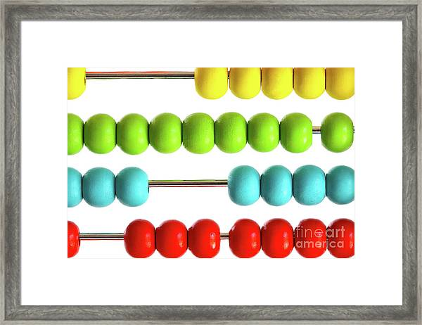 Closeup Of Bright  Abacus Beads On White Framed Print