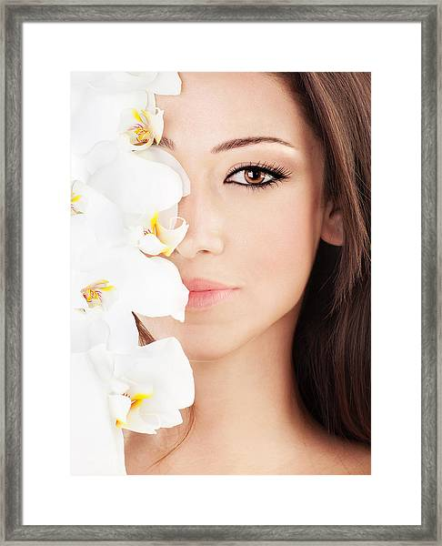 Closeup On Beautiful Face With Flowers Framed Print