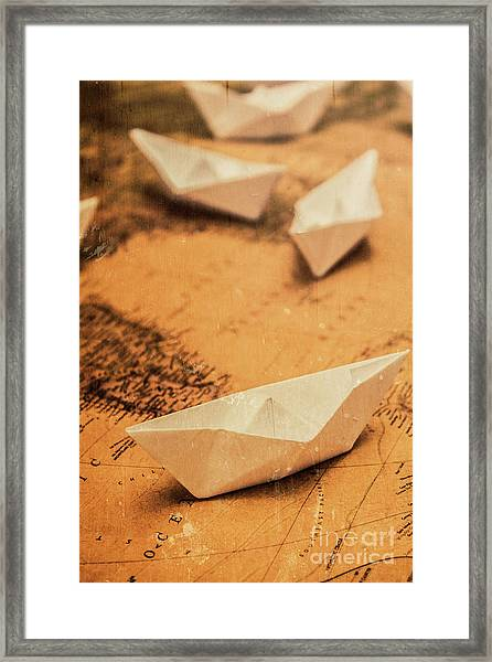 Closeup Toned Image Of Paper Boats On World Map Framed Print