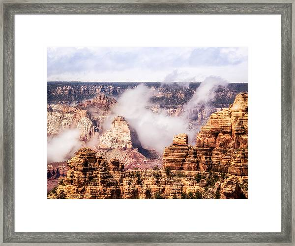 Framed Print featuring the photograph Clouds Lifting From Grand Canyon by Claudia Abbott