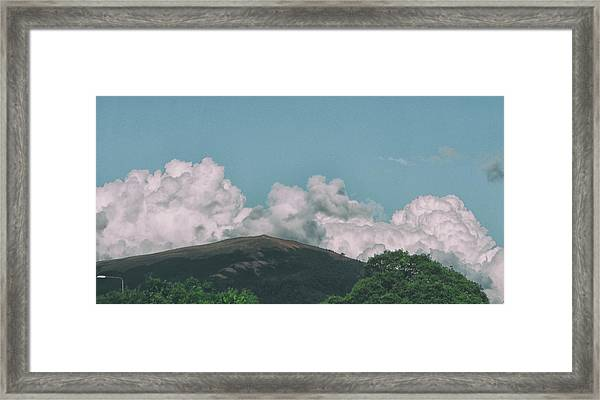 Clouds On The Hill Framed Print
