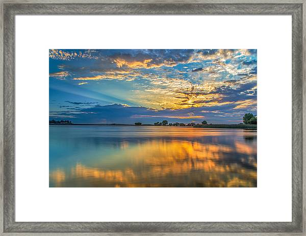 Clouds Reflected At Sunrise Framed Print