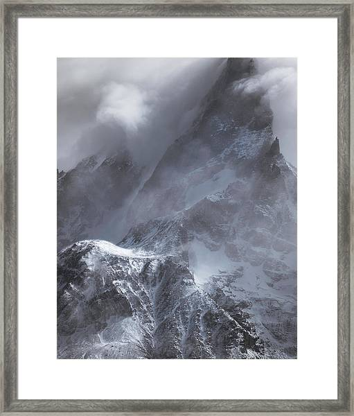 Clouds Rolling Over The Tops Of The Mountain In Torres Del Paine, Chile Framed Print