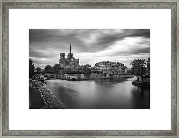 Cloudy Day On The Seine Framed Print