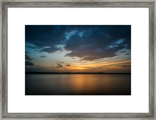 Cloudy Lake Sunset Framed Print