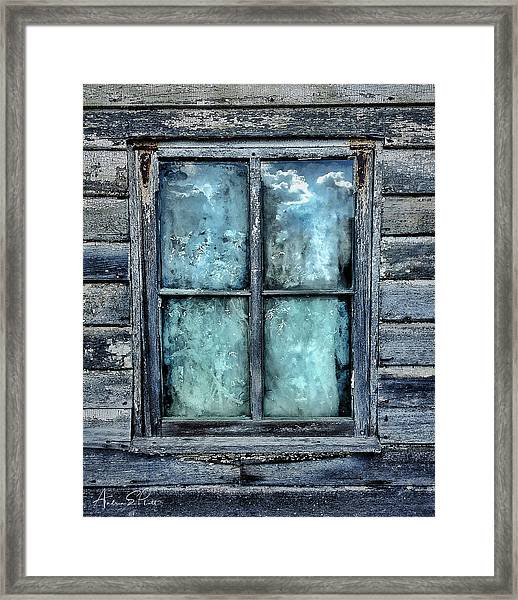 Cloudy Window Framed Print