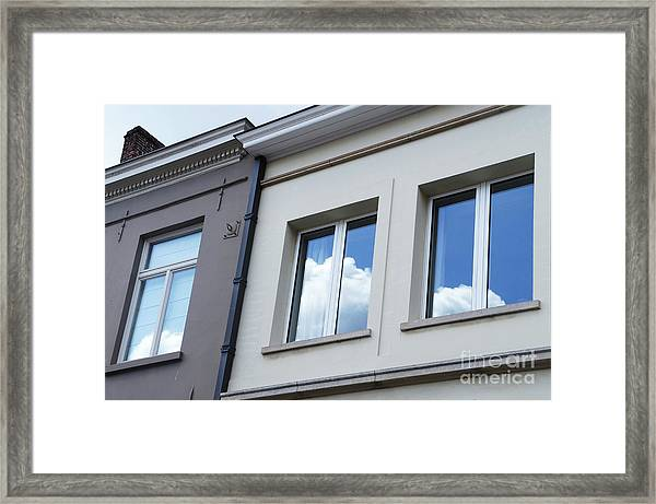 Cloudy Windows Framed Print