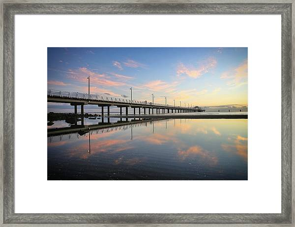 Colourful Cloud Reflections At The Pier Framed Print