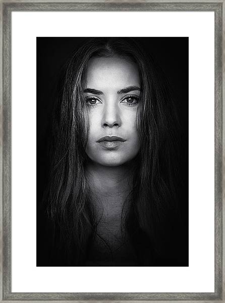 Coming From The Dark Framed Print