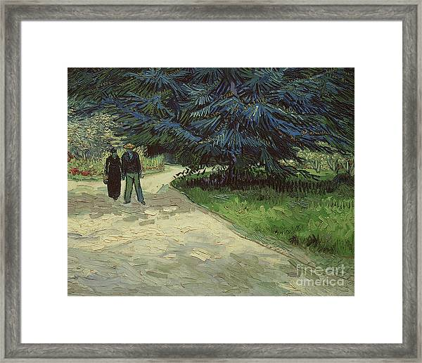 Couple In The Park Framed Print