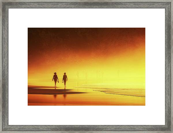 Couple Of Women Walking On Beach Framed Print