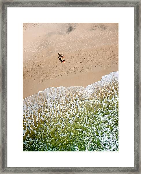 Couple Walking On Tallow Beach Framed Print