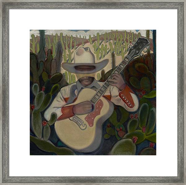 Cowboy In The Cactus Framed Print