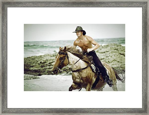 Cowboy Riding Horse On The Beach Framed Print