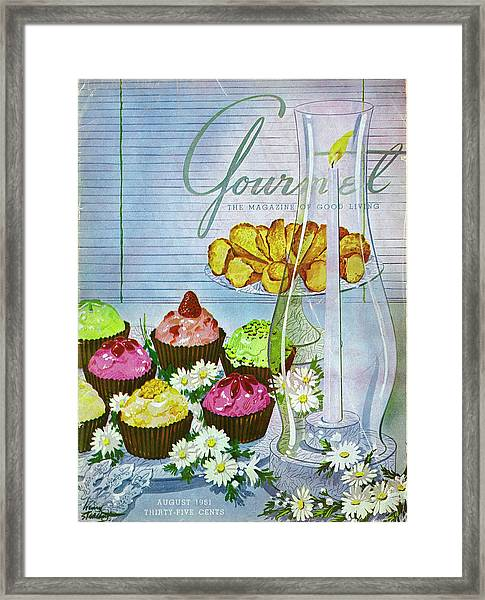 Cupcakes And Gaufrettes Beside A Candle Framed Print