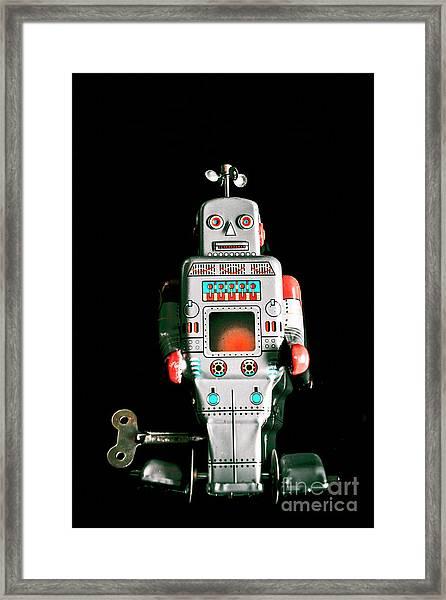 Cute 1970s Robot On Black Background Framed Print