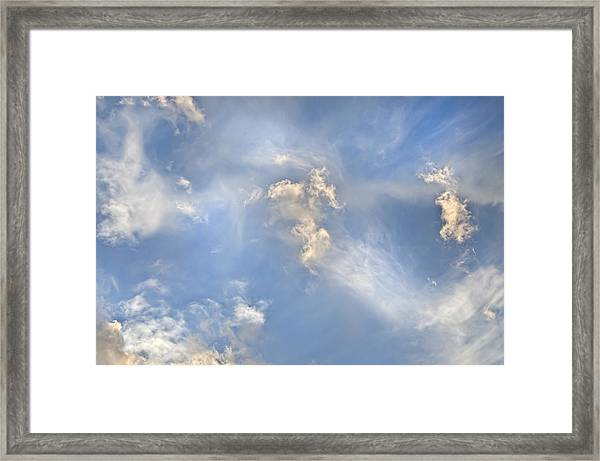 Dancing Clouds Framed Print