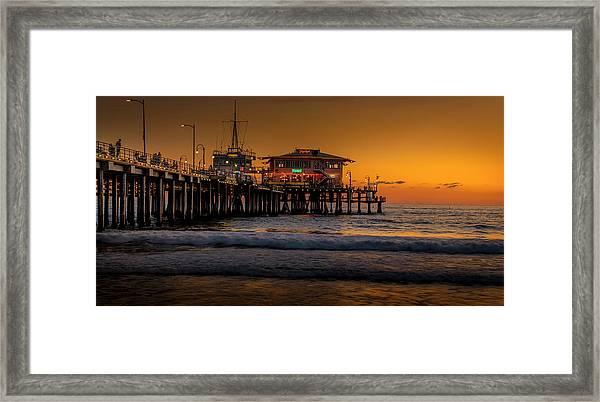 Daylight Turns Golden On The Pier Framed Print