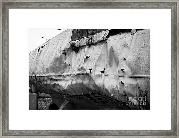 depth charge damage to u-534 submarine museum at u-boat story Liverpool Merseyside UK Framed Print