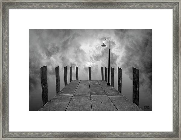 Dock And Clouds Framed Print