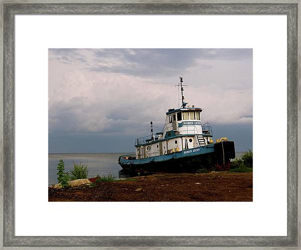Docked On The Shore Framed Print