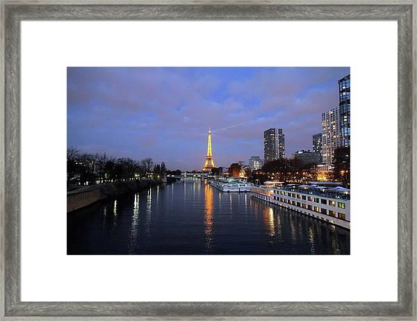 Eiffel Tower Over The Seine Framed Print