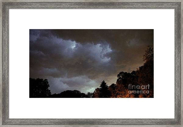 Electric Sky Of Faces Framed Print