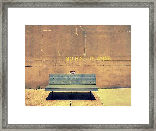 Empty Bench And Warning Framed Print