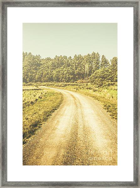Empty Curved Gravel Road In Tasmania, Australia Framed Print