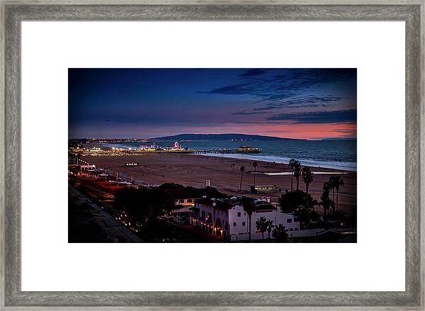 Evening Glow On The Pier Framed Print