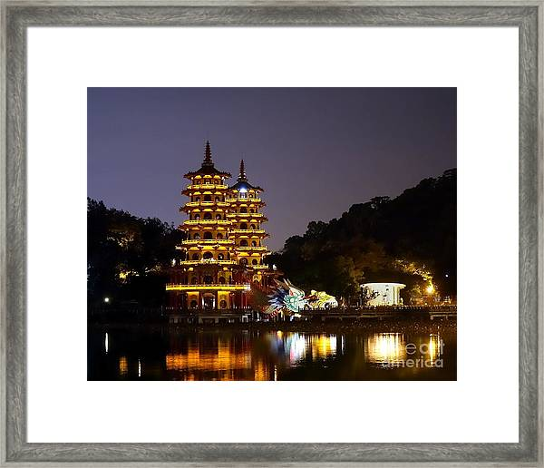 Evening View Of The Dragon And Tiger Pagodas In Taiwan Framed Print