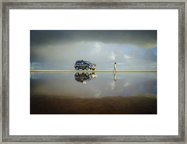 Exploring The Beach On A Rainy Day Framed Print