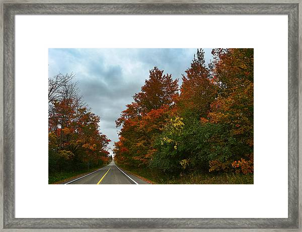 Fall Colors Dramatic Sky Framed Print