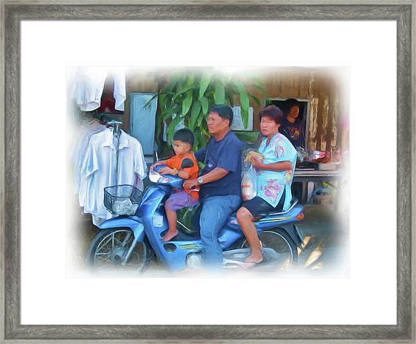 Family On Bike Framed Print