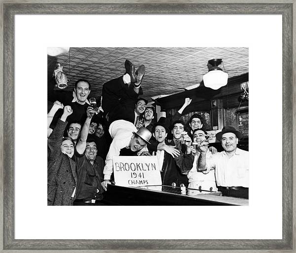 Fans Cheer A Brooklyn Dodgers Pennant Framed Print by Everett
