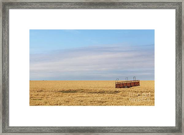Farm Trailer In The Middle Of Field Framed Print