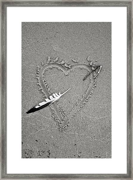 Feather Arrow Through Heart In The Sand Framed Print