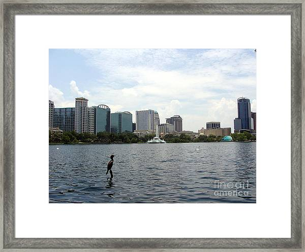 Feathered Fisherman Framed Print