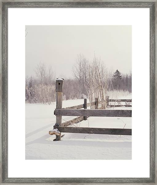 Fence And Birdhouse In The Snow Framed Print by Gillham Studios