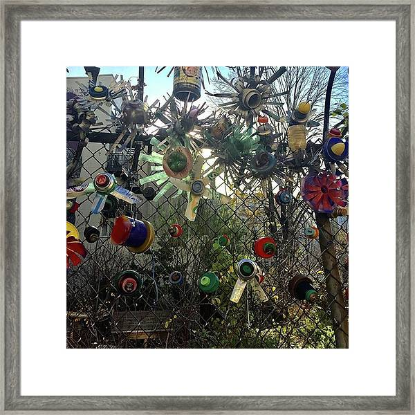 Fence Decorations Surrounding A Framed Print by Gina Callaghan