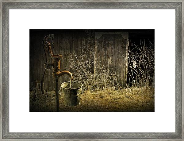 Fetching Water From The Old Pump Framed Print