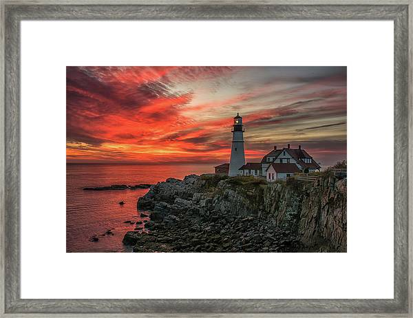 Fiery Sunrise At Portland Head Light Framed Print