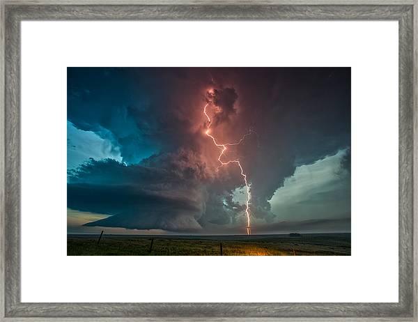 Fire In The Sky. Framed Print