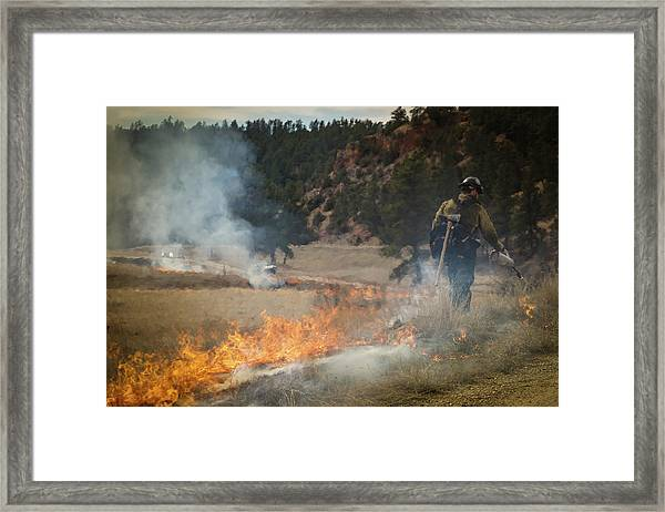 Framed Print featuring the photograph Firefighter Ignites The Pleasant Valley Prescribed Fire by Bill Gabbert