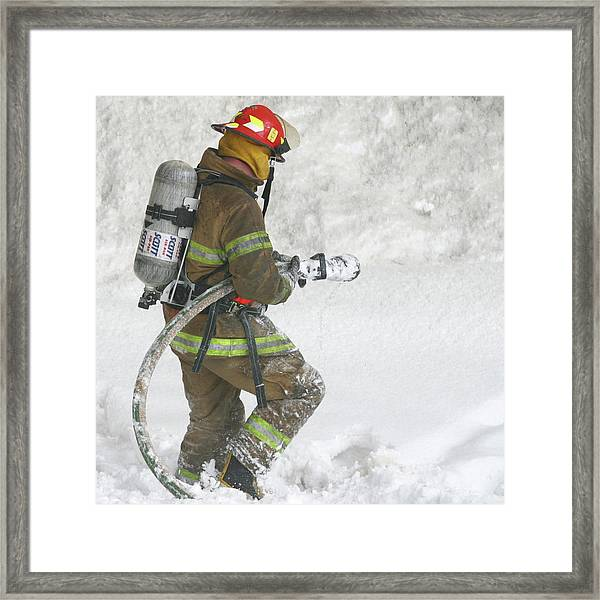 Firefighter In The Snow Framed Print by Jack Dagley