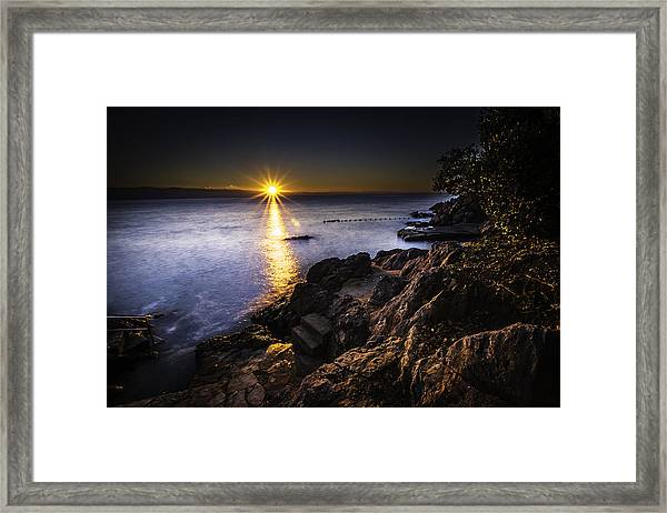 First Rays Over The Adriatic Framed Print