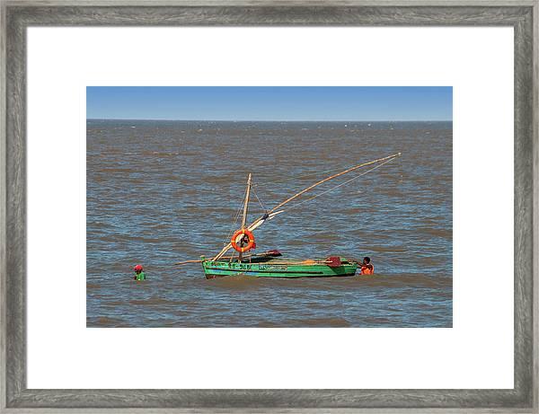 Fishermen Pulling Boat Framed Print