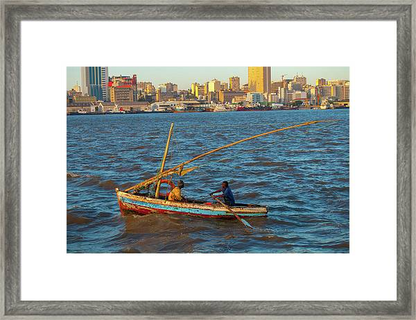 Fishermen Rowing Near Maputo Framed Print