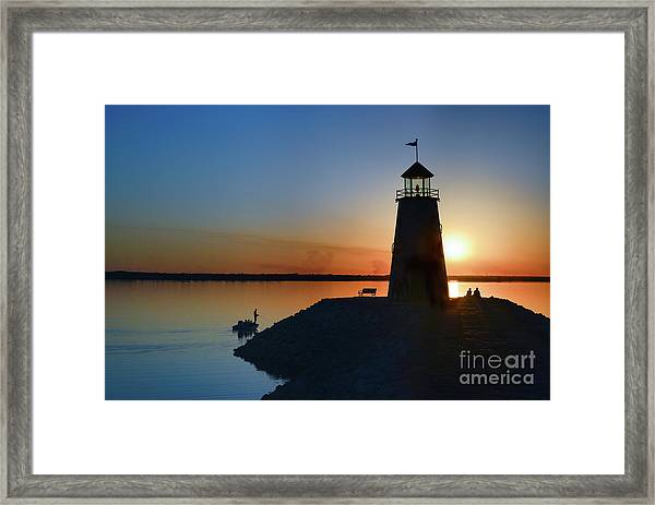 Fishing At The Lighthouse Framed Print