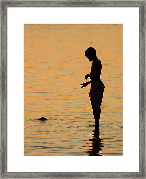 Fishing Boy At Sunset Framed Print